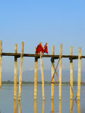 Buddhist monks walking on U Bein bridge, Amarapura, Myanmar Stock Image