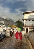 Buddhist monks walking under umbrella royalty free stock photos