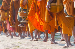 The Buddhist monks was walking on the sidewalk. In Thailandn Stock Images
