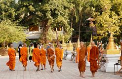 Buddhist Monks at Wat Prasing, Chiang Mai, Thailand. Young Buddhist Monks walking at Wat Prasing, Chiang Mai, Thailand Photo taken few days after the death of stock photo