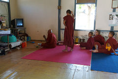 Buddhist monks watching soccer game Stock Images