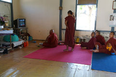 Buddhist monks watching soccer game Royalty Free Stock Photography