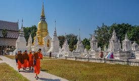 Buddhist monks in white temple stock photos