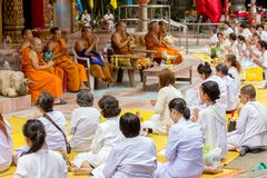 Buddhist monks and women praying Stock Photos