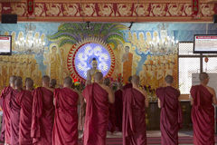 Buddhist Monks Worshipping Buddha in Temple Royalty Free Stock Images