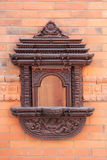 Buddhist niches. Old buddhist niches window on the brick wall in Nepal stock images