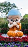 Buddhist novice model. Chiang rai,Thailand-December 30,2014 : Buddhist novice dolls with dharma puzzle in Rai Cherntawan meditation center stock images