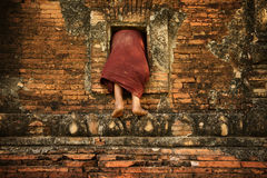 Buddhist novice monk climbing into monastery royalty free stock images