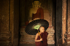 Buddhist novice monk inside monastery royalty free stock photos