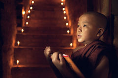Buddhist novice monk learning in monastery royalty free stock photography