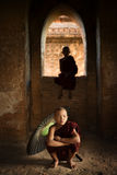 Buddhist novice monks inside temple royalty free stock photography