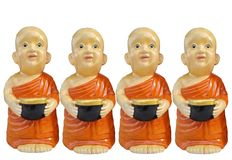 Buddhist novice resin characters holding alms bowl in hand isolated on white background. Buddhist novice characters holding alms bowl in hand isolated on white royalty free stock image