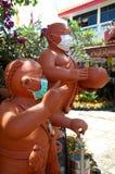 Buddhist novice statue Royalty Free Stock Photos