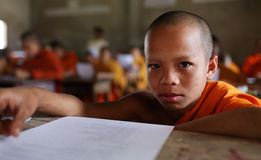 Buddhist novice studying in Luang Prabang, Laos. Buddhist novice studying at a monastic school in Luang Prabang, Laos royalty free stock image
