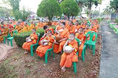 Buddhist novice wait for receive food offerings. Trang, Thailand - April 13, 2016: Buddhist novice and monk wait for receive food offerings for Thai New Year royalty free stock image