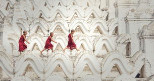 Buddhist novice are walking in temple. Myanmar royalty free stock image
