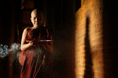 Buddhist novices learning. Young novice monk learning inside monastery Royalty Free Stock Images