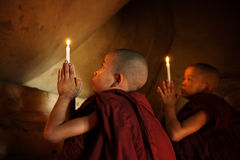 Buddhist novices praying Royalty Free Stock Photo