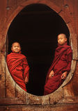 Buddhist novices at a teak monastery Royalty Free Stock Photo