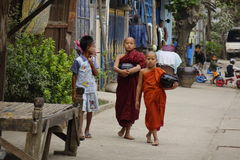 Buddhist novices walking for morning alms Stock Photo