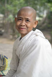 Angkor Wat, Cambodia, Buddhist nun. Khmer Cambodian Buddhist nun in white wrap smiling outdoors in Angkor Thom, Angkor Wat, Siem Reap, Cambodia Royalty Free Stock Image