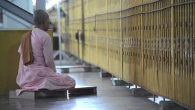 A Buddhist nun prays in the temple stock footage