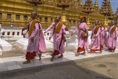 Buddhist nuns in Myanmar. Buddhist nuns chanting walking at Temple in Bagan, Myanmar, Burma Royalty Free Stock Photos