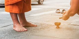 Buddhist offer food to the monks/ to give alms to the monks and pour water Stock Photography