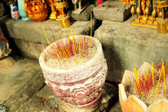 Buddhist offerings. Incense sticks in a bowl during buddhist offering Royalty Free Stock Photos