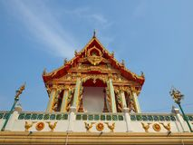 Buddhist Ordination Hall soaring into blue sky Royalty Free Stock Photography