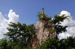 Buddhist Pagoda in Burma. Buddhist Pagoda in Burma at the top of a rock Stock Photography