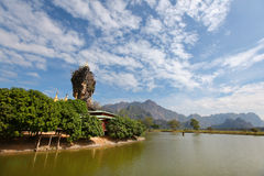 Buddhist pagoda on a rock beside river in Burma Stock Image