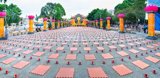Buddhist party came prepared with hundreds candles lined Buddhists seat. Ho Chi Minh City, Vietnam - January 3, 2018: Buddhist party came prepared with hundreds Stock Photos