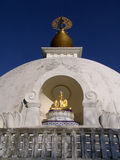 Buddhist peace pagoda. View of the left side of the leverett peace pagoda in massachusetts. here we see the buddha sitting cross legged in prayerful meditation Stock Image