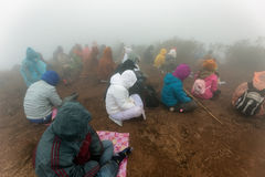 Buddhist people praying in the fog Stock Image