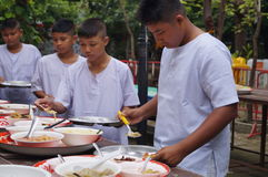 Buddhist people recieve food , Bangkok, Thailand Royalty Free Stock Photography