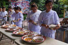 Buddhist people recieve food , Bangkok, Thailand Stock Photo