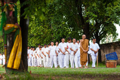 Buddhist peoples walk and pray around temple Stock Photo