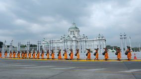Buddhist Pilgrimage. Monks from Wat Phra Dhammakaya make a pilgrimage through the Thai capital past Dusit Palace on January 25, 2013 in Bangkok, Thailand. 1,128 Stock Photo