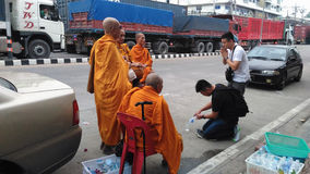 Buddhist Pilgrimage , ritual of a gift of food for monk Stock Image