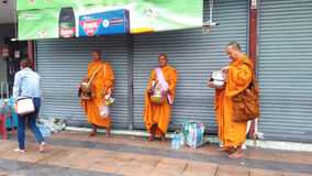 Buddhist Pilgrimage , ritual of a gift of food for monk Stock Photography