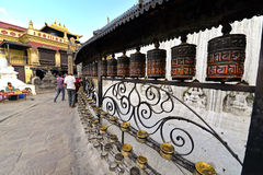 Buddhist pilgrims circling around the Swayambhunath stupa and sp Stock Images