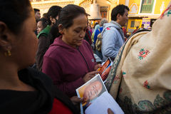Buddhist pilgrims near stupa Boudhanath during festive Puja of H.H. Drubwang Padma Norbu Rinpoche's reincarnation's. Unidentified Buddhist pilgrims near stupa royalty free stock photography