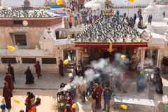 Buddhist pilgrims near stupa Boudhanath during festive solemn Puja Royalty Free Stock Photography