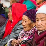 Buddhist pilgrims near stupa Boudhanath during festive solemn Puja Royalty Free Stock Photo