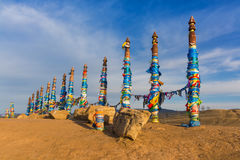 Buddhist pillars in the sacred place of worship near Cape, Baikal Royalty Free Stock Photo
