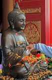 Buddhist pours water on buddha statue. Buddhist pours water on buddha statue during the Songkran festival in Bangkok Stock Photos