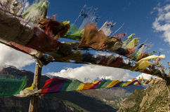 Buddhist Pray Flag. With Annapurna mountains in the back at the Annapurna Circuit, Nepal stock image