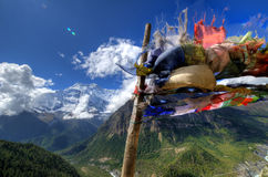 Buddhist Pray Flag. With Annapurna mountains in the back at the Annapurna Circuit, Nepal stock photo