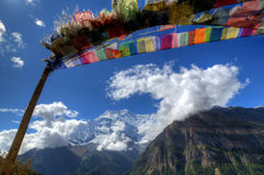 Buddhist Pray Flag. With Annapurna mountains in the back at the Annapurna Circuit, Nepal stock photography